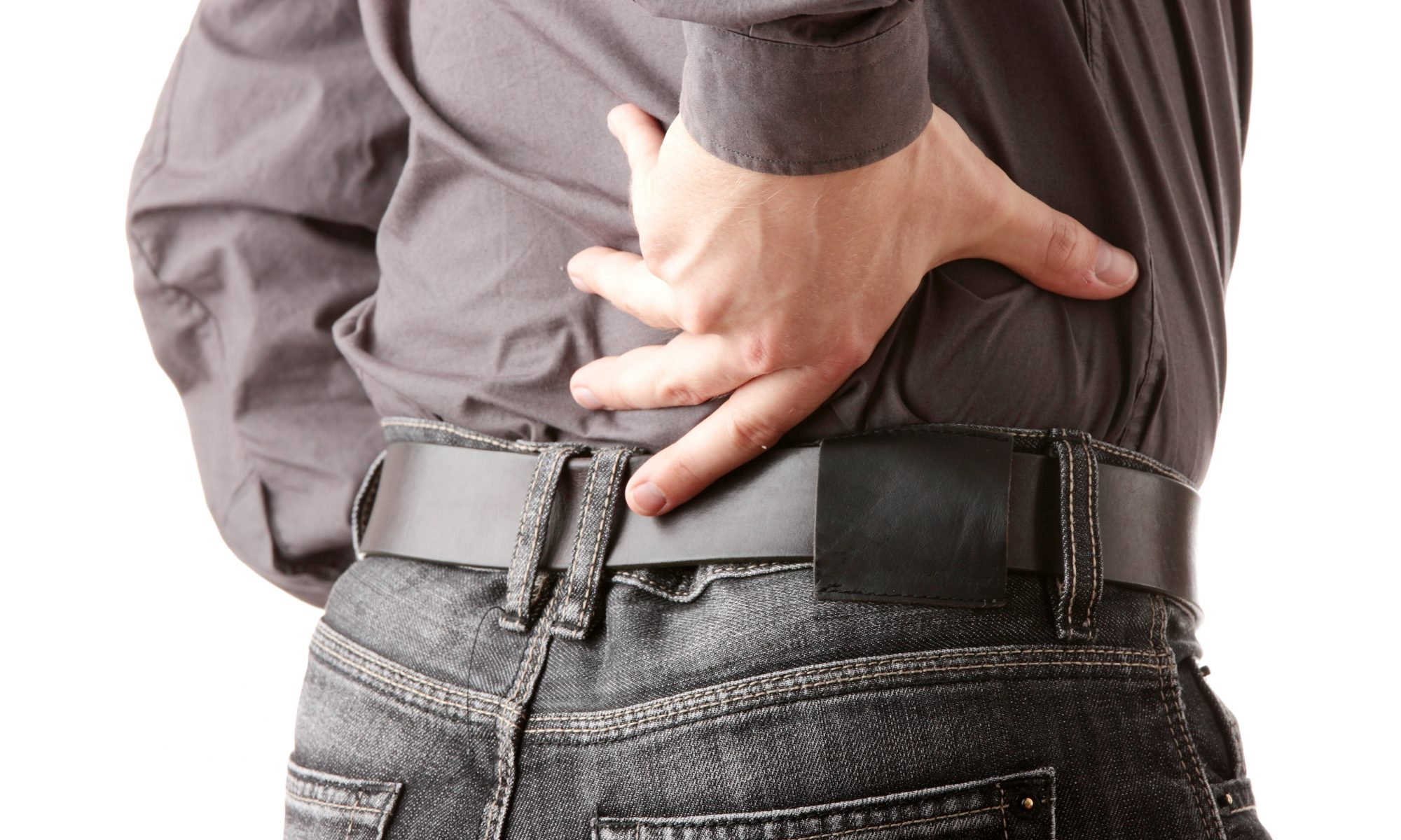 A man with pain shooting up his back. (Zoonar/Thinkstock)