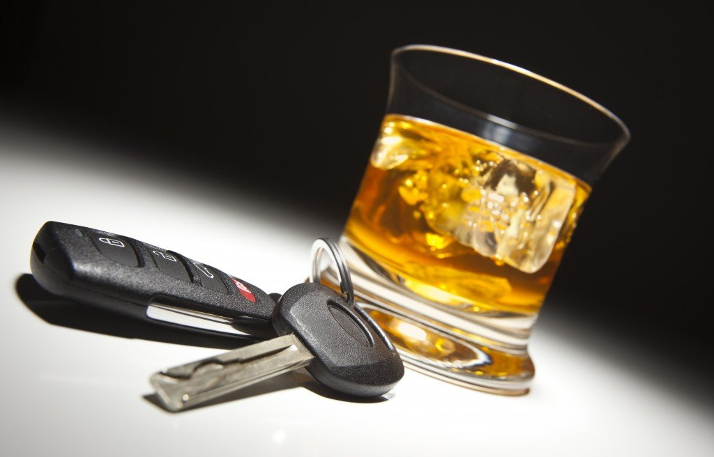 Alcoholic drink and car keys. (iStockphoto)