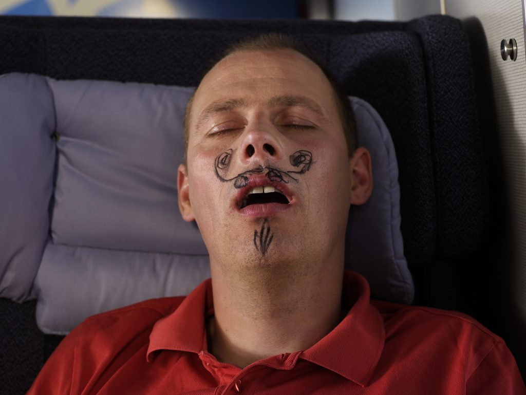 A tired man who did not wake up when someone drew a mustache on his face! (Ulrik Tofte)