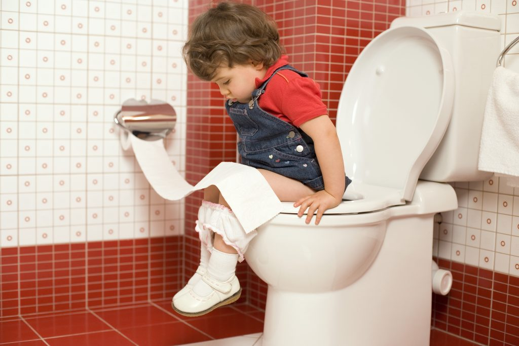 A kid learning to sit on a toilet. (Comstock/Thinkstock)