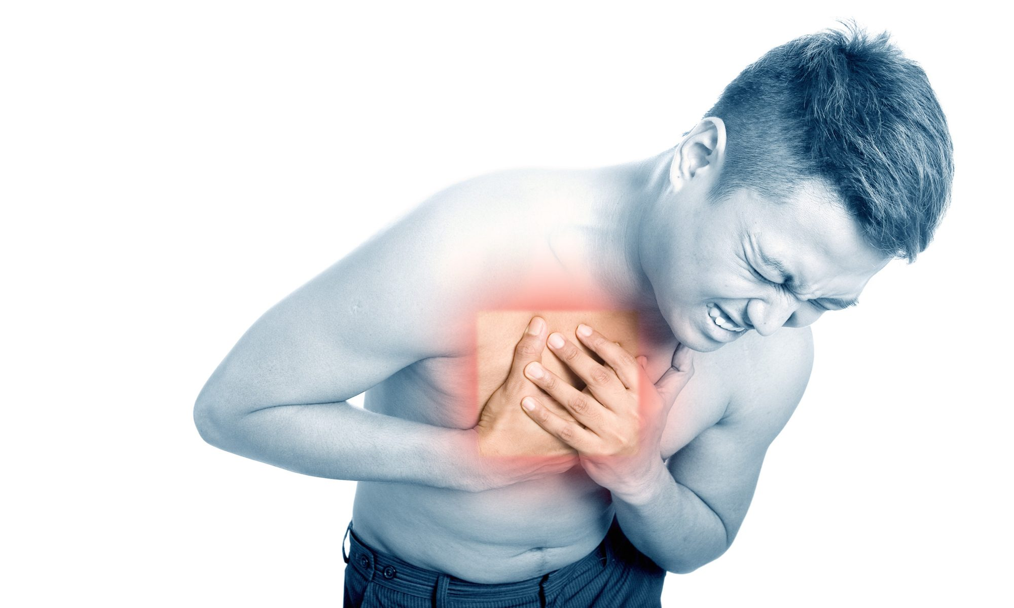 A young man suffering from chest pain. (Hemera/Thinkstock)