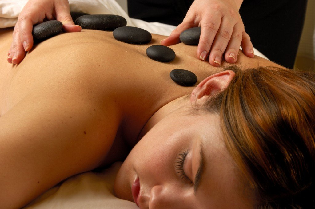Hot stone massage therapy. (iStockphoto/Thinkstock)