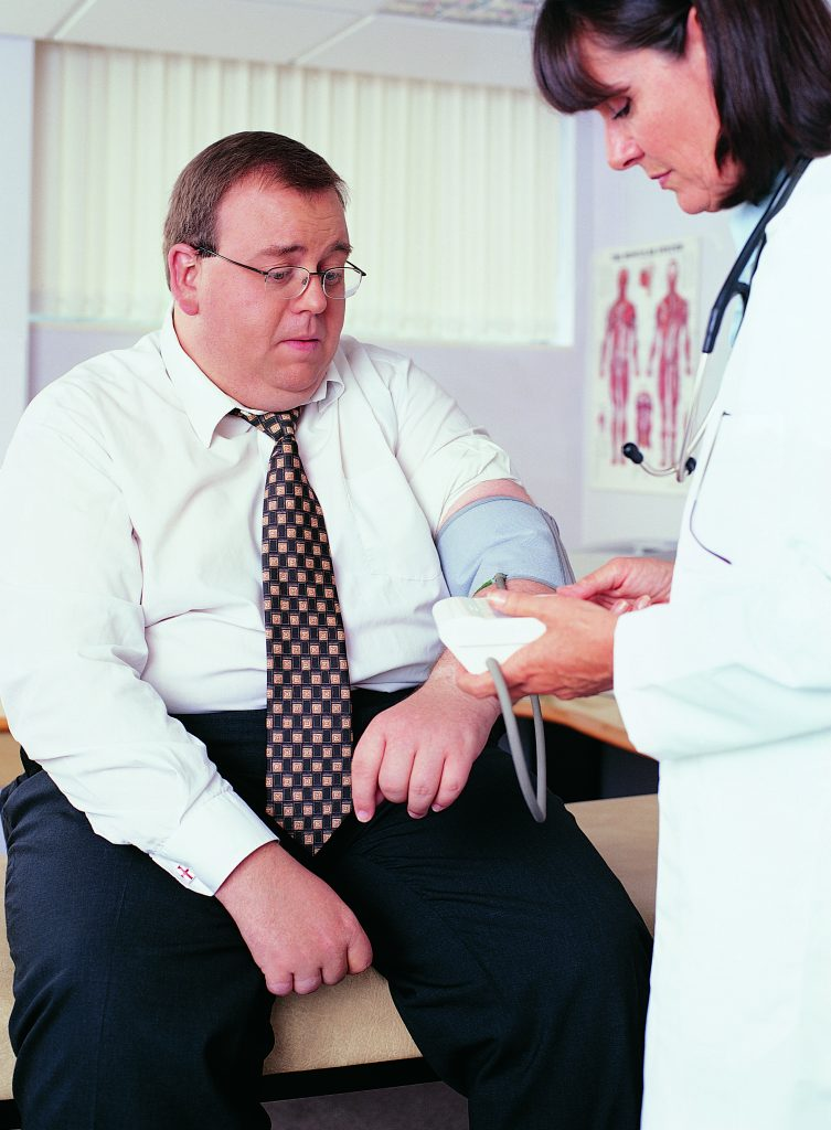 An overweight man getting his blood pressure checked. (Digital Vision/Thinkstock)