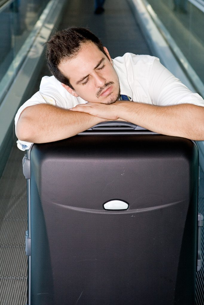 A tired traveler. (iStockphoto/Thinkstock)