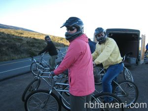 After watching the sunrise from the volcano crater at 10,000 ft. Alia (pink jacket), Hussein (yellow jacket) and the rest of the group get ready to bike down the mountain on Volcano Chrome Cruiser Bikes.