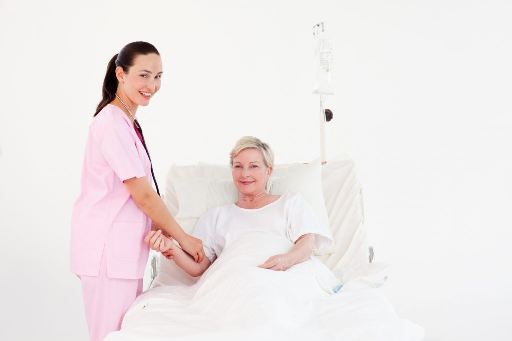 Nurse helping a senior patient. (Wavebreak Media)