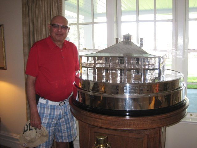 Noorali with the Masters trophy at the Augusta National Golf Club.
