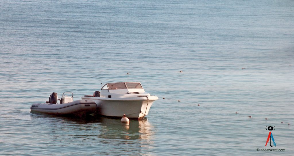 A boat waiting to sail off the coast of Antigua. (Dr. Noorali Bharwani)