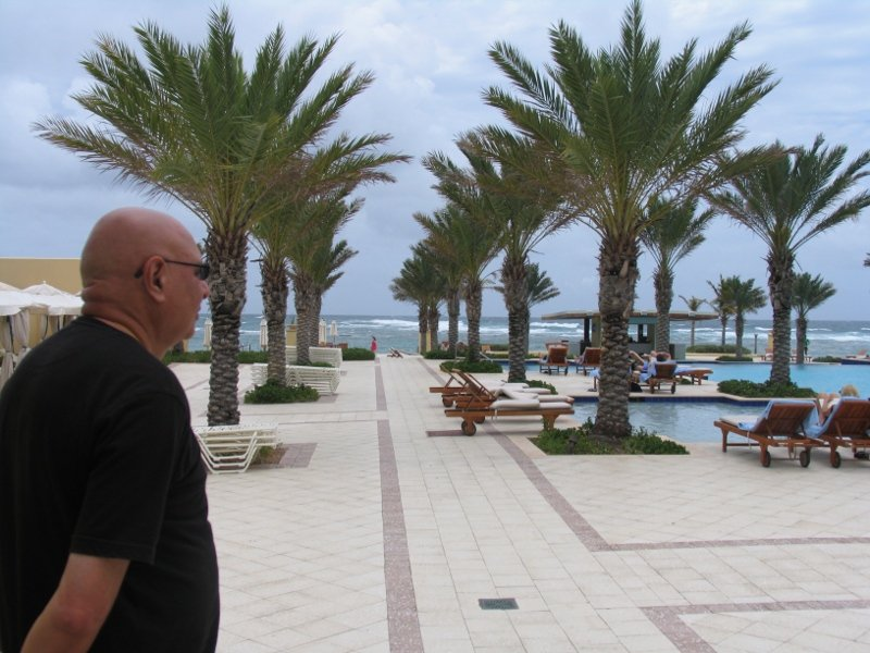 Photograph shows Noorali savoring the beauty of St. Maarten sea side resort (obviously not a nudist colony).