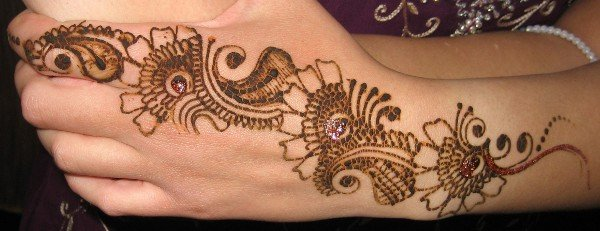 Traditional henna application.