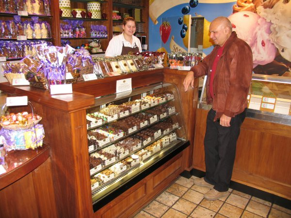 Here is a picture of me admiring chocolate at Rocky Mountain Chocolate Factory in the Medicine Hat mall. In the background is Jody Jesse, assistant manager.