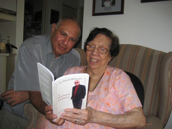 Noorali and his mother, reading his book, A Doctor's Journey.